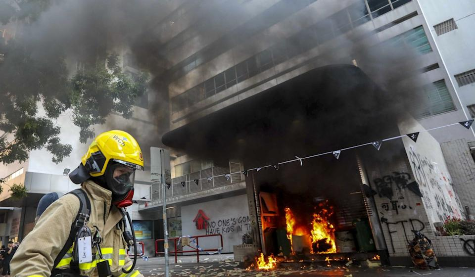 Firefighters respond to a fire at an exit of Wan Chai MTR Station. Photo: Felix Wong