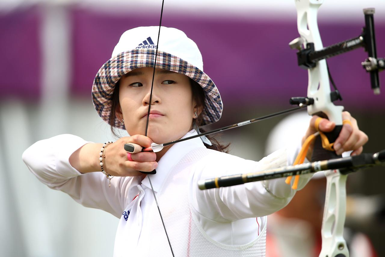 LONDON, ENGLAND - JULY 27: Bobae Ki of Korea prepares to arch during the Archery Ranking Round on Olympics Opening Day as part of the London 2012 Olympic Games at the Lord's Cricket Ground on July 27, 2012 in London, England.  (Photo by Paul Gilham/Getty Images)