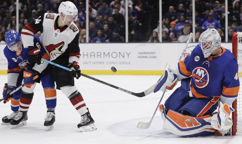 Arizona Coyotes' Richard Panik (14) watches as New York Islanders goaltender Robin Lehner (40) stops a shot on the goal as Ryan Pulock (6) defends him during the third period of an NHL hockey game Sunday, March 24, 2019, in Uniondale, N.Y. The Islanders won 2-0. (AP Photo/Frank Franklin II)