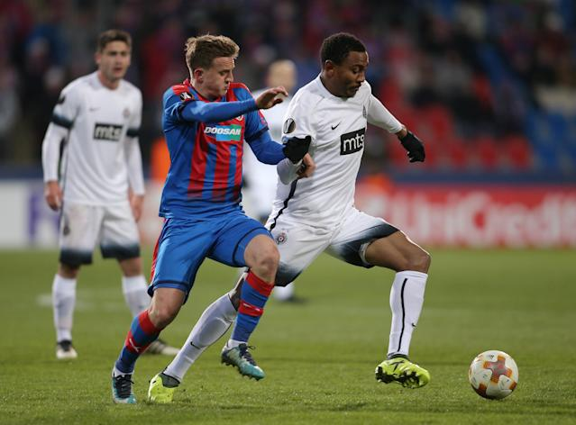 Soccer Football - Europa League Round of 32 Second Leg - Viktoria Plzen vs Partizan Belgrade - Doosan Arena, Plzen, Czech Republic - February 22, 2018 Partizan Belgrade's Leandre Tawamba in action with Viktoria Plzen's Jan Kopic REUTERS/Milan Kammermayer