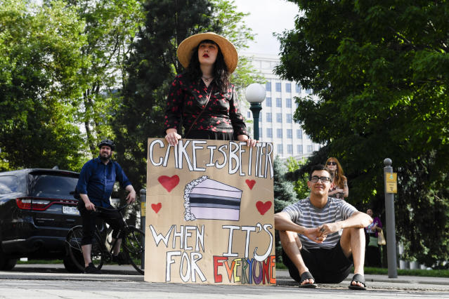 A rally in support of David Mullins and Charlie Craig after the Supreme Court ruled in favor of baker Jack Phillips, who refused to make a wedding cake for the same-sex couple in 2012. (Photo: Aaron Ontiveroz/The Denver Post via Getty Images)