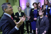 U.S. Department of Health and Human Services (HHS) Secretary Xavier Becerra, left, speaks to Oklahoma Medicaid advocates following a news conference Thursday, July 1, 2021, in Tulsa, Okla., as Oklahoma expands its Medicaid program. (AP Photo/Sue Ogrocki)