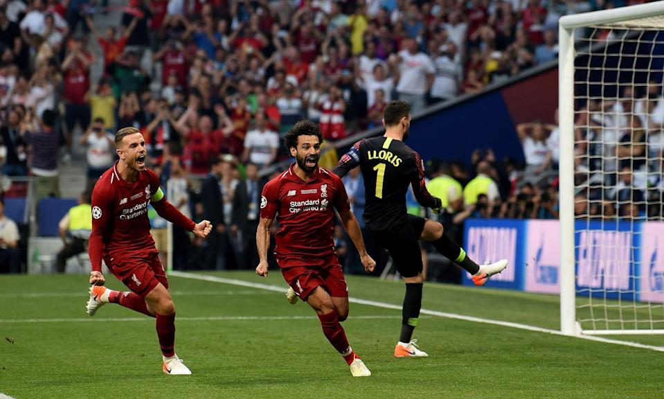 MADRID, SPAIN - JUNE 01: (THE SUN OUT, THE SUN ON SUNDAY OUT) Mohamed Salah  of Liverpool  scores from the penalty spot  and celebrates during the UEFA Champions League Final between Tottenham Hotspur and Liverpool at Estadio Wanda Metropolitano on June 01, 2019 in Madrid, Spain. (Photo by John Powell/Liverpool FC via Getty Images)