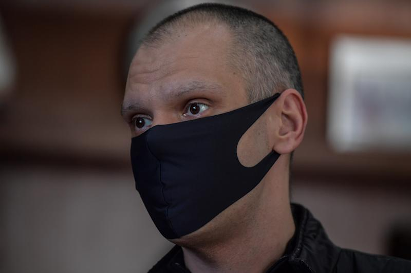 Sao Paulo's Mayor Bruno Covas wears a face mask as a protection against the new coronavirus as he speaks during an interview with AFP at the City Hall of Sao Paulo, Brazil, on May 21, 2020. - Sao Paulo is the city that has been most hardly hit the COVID-19 in Brazil. (Photo by NELSON ALMEIDA / AFP) (Photo by NELSON ALMEIDA/AFP via Getty Images)
