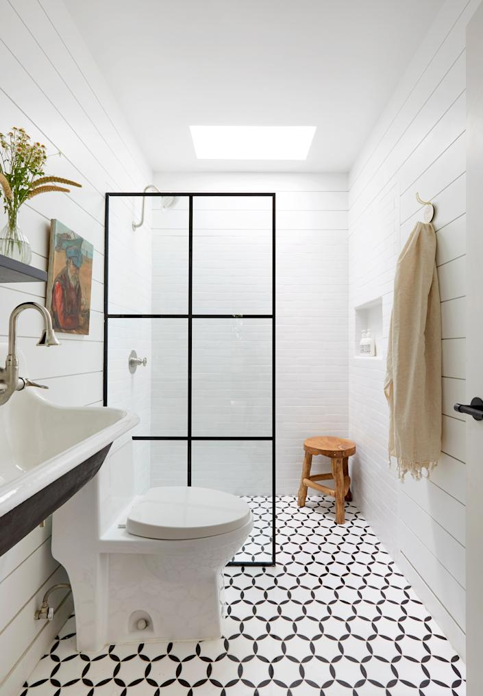 "<div class=""caption""> <strong>AFTER:</strong> The guest bathroom contains a marble mosaic floor and <a href=""https://www.cletile.com/pages/thin-brick-tile"" rel=""nofollow noopener"" target=""_blank"" data-ylk=""slk:Clé"" class=""link rapid-noclick-resp"">Clé</a> Tile thin glazed brick seamless shower. </div>"