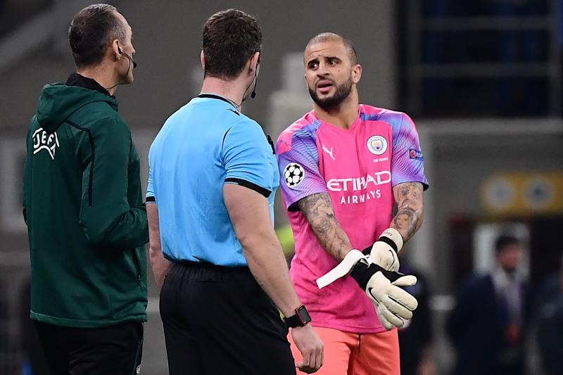 Manchester City fullback Kyle Walker (right) prepares to assume goalkeeping duties on Wednesday against Atalanta. (Getty Images)