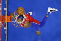 Philadelphia 76ers' Dwight Howard watches his shot go in the basket during the first half of an NBA basketball game against the Los Angeles Lakers, Wednesday, Jan. 27, 2021, in Philadelphia. (AP Photo/Matt Slocum)