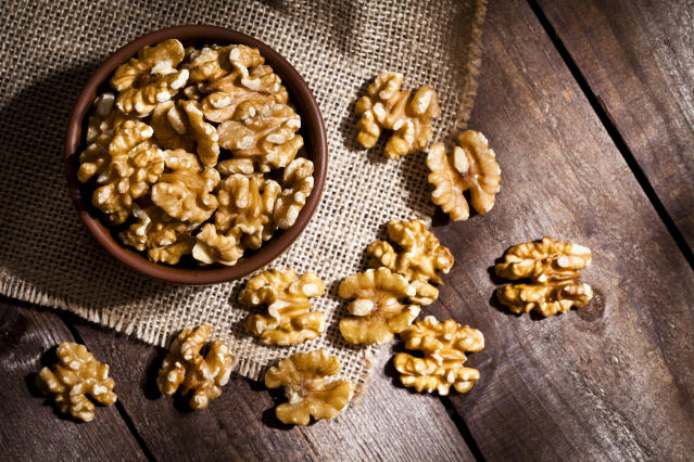 Eating walnuts corresponded with a gut bacteria boost and cholesterol decline. [Photo: Getty]