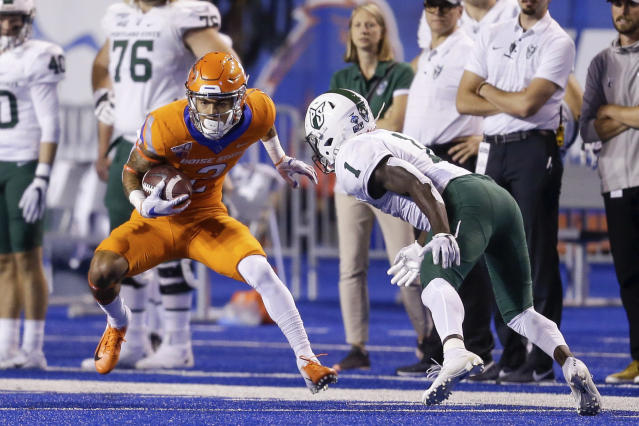 Boise State wide receiver Khalil Shakir (2) turns upfield against Portland State safety Romeo Gunt (1) after a reception during the first half of an NCAA college football game Saturday, Sept. 14, 2019, in Boise, Idaho. (AP Photo/Steve Conner)