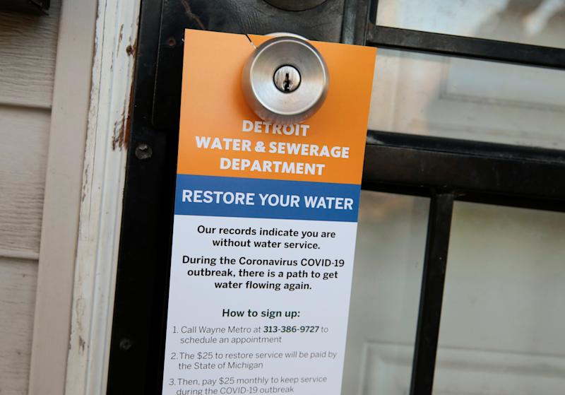 A notice by the Detroit Water and Sewerage Department hangs on a house doorknob to inform residents how to restore service in response to the coronavirus outbreak, in Detroit, Michigan, on March 13. (Photo: REUTERS/Rebecca Cook)
