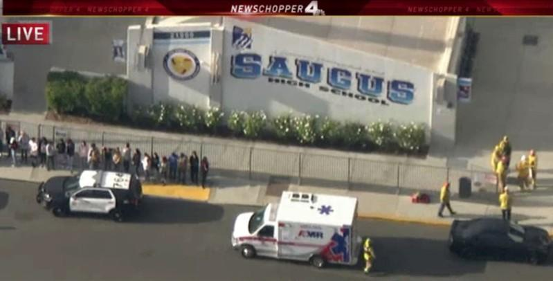 Police and emergency vehicles on the scene of a shooting at Saugus high school in Santa Clarita