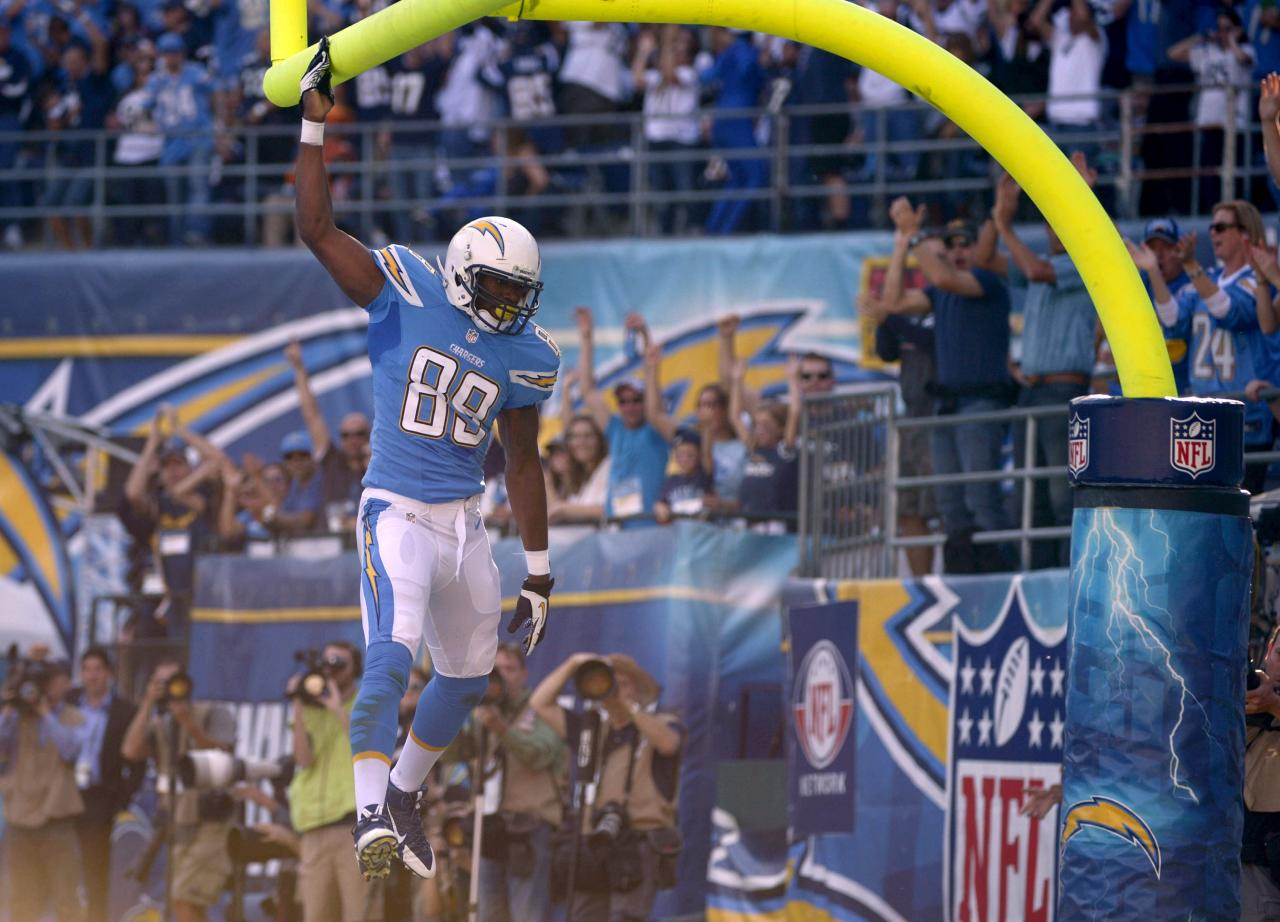 SAN DIEGO, CA - DECEMBER 1: Ladarius Green #89 of the San Diego Chargers celebrates scoring a touchdown by dunking the ball on the uprights against the Cincinnati Bengals during their game on December 1, 2013 at Qualcomm Stadium in San Diego, California. (Photo by Donald Miralle/Getty Images)