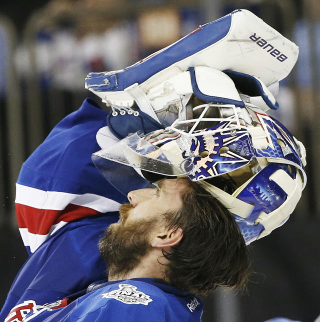 New York Rangers goalie Henrik Lundqvist (30) adjusts his mask during a timeout against the Los Angeles Kings in the third period during Game 4 of the NHL hockey Stanley Cup Final, Wednesday, June 11, 2014, in New York. The Rangers won the game 2-1. (AP Photo/Kathy Willens)