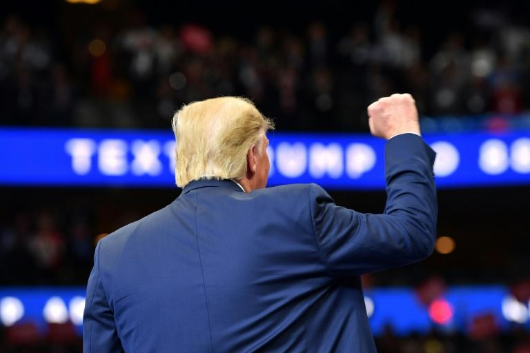 US President Donald Trump is seen speaking at a rally in Dallas, Texas, on October 17, 2019, during one of his most difficult weeks in office
