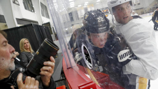 Pittsburgh Penguins' John Marino, right, checks Samuel Poulin along the boards during NHL hockey practice on the team's first day of training camp, Friday, Sept. 13, 2019, in Cranberry Township, Butler County, Pa. (AP Photo/Keith Srakocic)