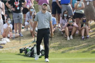 Scottie Scheffler reacts to missing his birdie putt attempt on the 16th green during a round of eight match at the Dell Technologies Match Play Championship golf tournament Saturday, March 27, 2021, in Austin, Texas. (AP Photo/David J. Phillip)