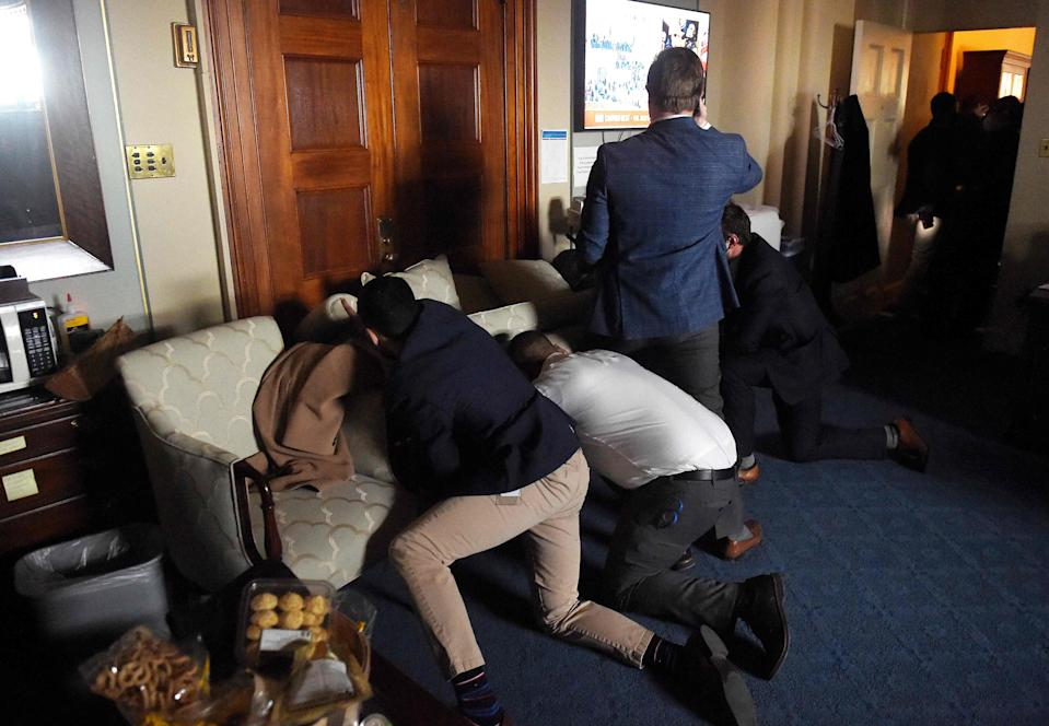 Congress staffers barricade themselves after Trump supporters stormed inside the U.S. Capitol in Washington, D.C., on Jan. 6, 2021.
