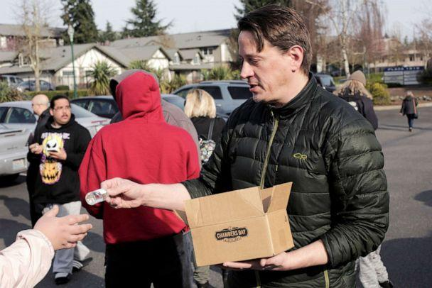 PHOTO: Co-owner Alan Davis distributes free hand sanitizers at Chambers Bay Distillery, which is creating the product and giving it away, during the coronavirus outbreak, in University Place, Washington, March 17, 2020. (David Ryder/Reuters)