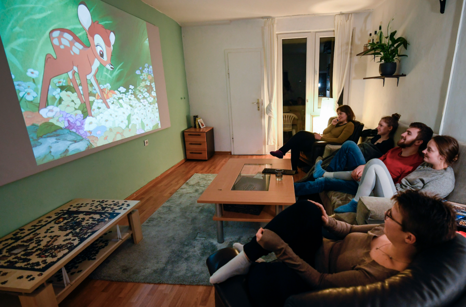 People watch Disney's 'Bambi' in Dortmund, Germany, on March 27, 2020. (Photo: INA FASSBENDER/AFP via Getty Images)