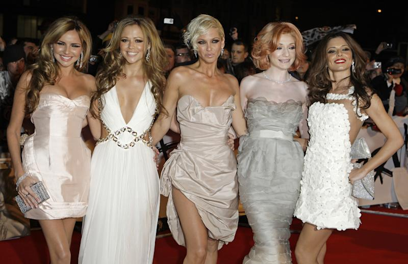 British group Girls Aloud, from left, Nadine Coyle, Kimberly Walsh, Sarah Harding, Nicola Roberts and Cheryl Cole arrive at the Brit Awards 2009 at Earls Court exhibition centre in London, England, Wednesday, Feb. 18, 2009. (AP Photo/Joel Ryan)
