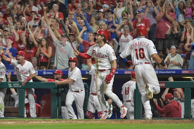 Sep 1, 2019; Philadelphia, PA, USA; Philadelphia Phillies right fielder Bryce Harper (3) celebrates as Philadelphia second baseman Cesar Hernandez (16) crosses the plate after a three run double by center fielder Scott Kingery (4) during the eighth inning of the game against the New York Mets at Citizens Bank Park. Mandatory Credit: John Geliebter-USA TODAY Sports