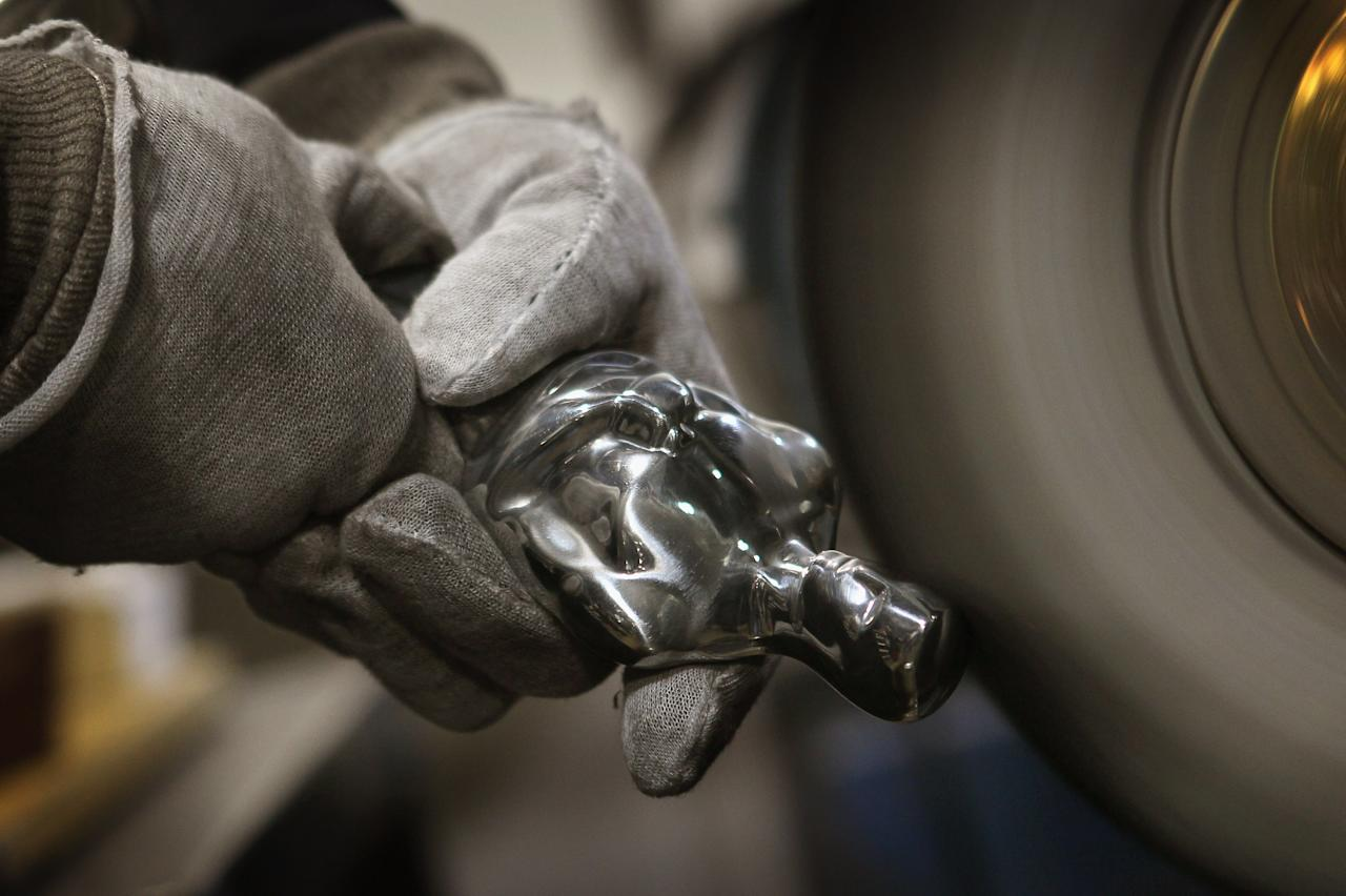 CHICAGO, IL - FEBRUARY 09:  A worker polishes an Oscar statuette at R.S. Owens & Company February 9, 2012 in Chicago, Illinois. R.S. Owens manufactures the Oscar statuettes which are presented at the annual Academy Awards by the Academy of Motion Picture Arts and Sciences. After the theft of the statuettes prior to the 2000 Academy Awards the company began casting the statuettes one year in advance of the show.  (Photo by Scott Olson/Getty Images)