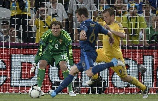French midfielder Yohan Cabaye (L) scores past Ukrainian goalkeeper Maxym Koval (C)