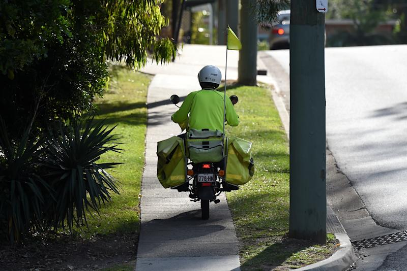 A file image of a postie on a suburban mail round. Source: AAP