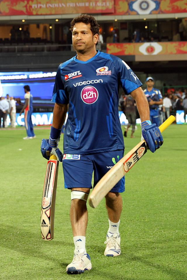 Sachin Tendulkar walks in during warmup session of match 2 of the Pepsi Indian Premier League between The Royal Challengers Bangalore and The Mumbai Indians held at the M. Chinnaswamy Stadium, Bengaluru  on the 4th April 2013Photo by Prashant BhootSPORTZPICS Use of this image is subject to the terms and conditions as outlined by the BCCI. These terms can be found by following this link:https://ec.yimg.com/ec?url=http%3a%2f%2fwww.sportzpics.co.za%2fimage%2fI0000SoRagM2cIEc&t=1506262555&sig=8SvlRjMialv9w7XXU7Eyyg--~D