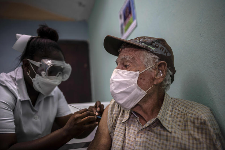A man gets a shot of the Cuban Abdala vaccine for COVID-19 Abdala at a doctors' office in Alamar on the outskirts of Havana, Cuba, Friday, May 14, 2021. Cuba has begun to immunize people this week with its own vaccines, Abdala and Soberana 02, the only ones developed by a Latin American country. (AP Photo/Ramon Espinosa)