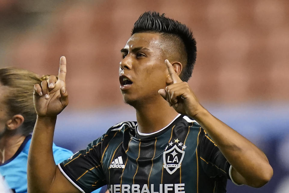 Los Angeles Galaxy midfielder Efrain Alvarez celebrates after scoring against the Vancouver Whitecaps in the second half during an MLS soccer match Wednesday, June 23, 2021, in Sandy, Utah. (AP Photo/Rick Bowmer)