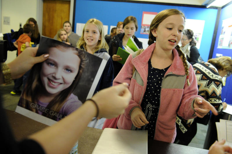 """This Sept. 15, 2013 image released by NBC shows Grace Gault, age 13, from Verona N.J., right, at an open casting call for the Von Trapp children in NBC's """"The Sound of Music,"""" at Grace Church School in New York. A remake of the 1965 film classic and the original 1959 Broadway production, starring Carrie Underwood and Stephen Moyer, will air on Dec. 5. (AP Photo/NBC, Virginia Sherwood)"""