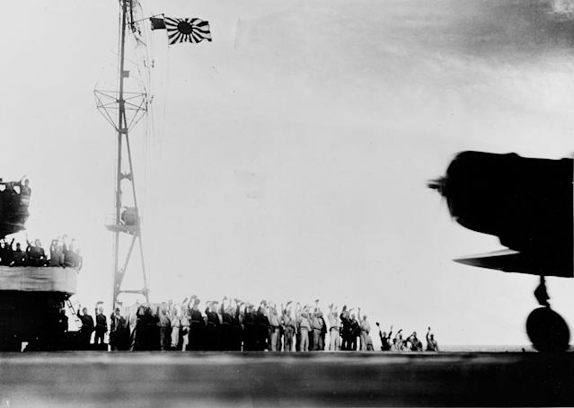 "<p>The crew of the Japanese carrier Shokaku cry ""banzai"" as a Type 97 Kate carrier attack plane takes off as the second wave attack is launched on Pearl Harbor on Dec. 7, 1941. (U.S. Navy/National Archives/Handout via Reuters) </p>"
