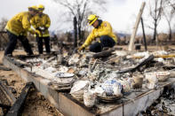 Firefighters sift through debris to recover keepsakes for residents after the Mountain View Fire tore though the Walker community in Mono County, Calif., Wednesday, Nov. 18, 2020. (AP Photo/Noah Berger)