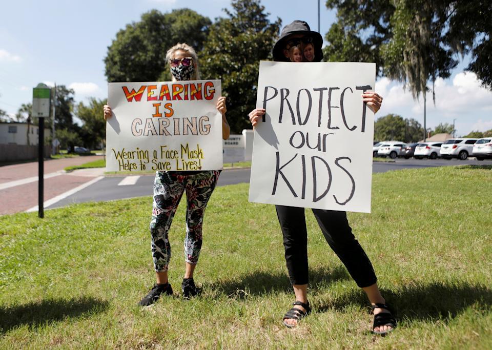 Supporters of wearing masks in schools protest before a Pinellas County Schools workshop to discuss the issue in Largo, Fla., on Aug. 9.