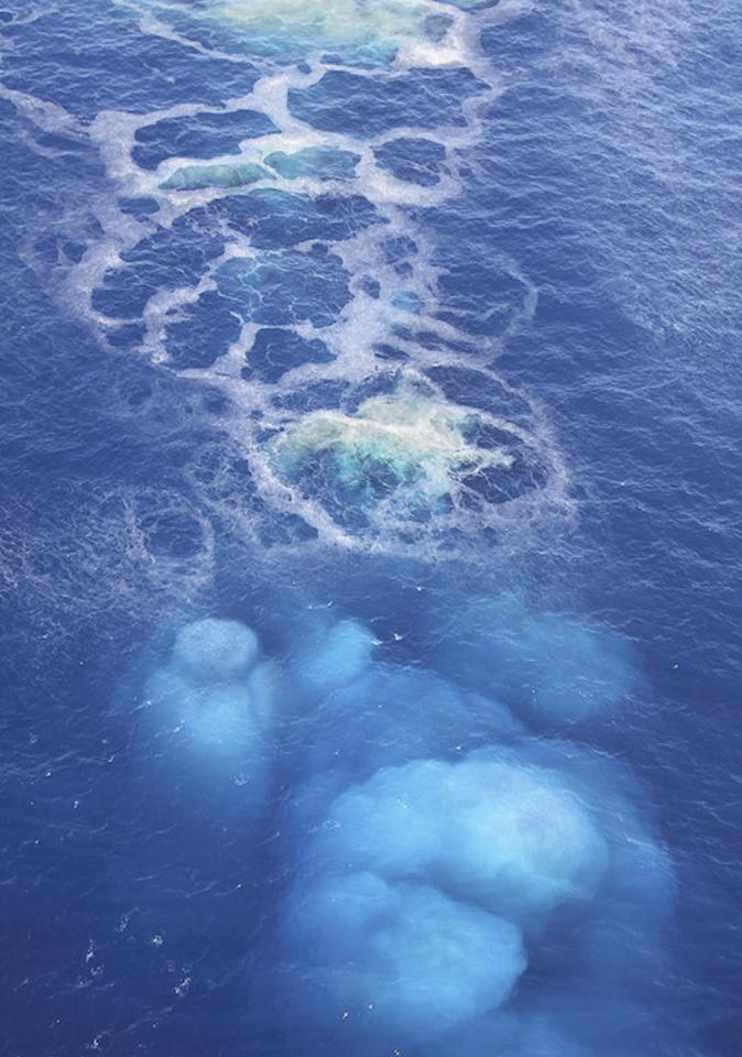 Volcanic activity in the sea off the Canary island of El Hierro  is seen in this areal  photo taken and released by the Canary Islands Government on Friday Nov. 4, 2011. The regional government of the Canary Islands on Saturday Nov. 5, 2011has ordered the evacuation of homes and road closures near the southern tip of El Hierro after two earth tremors and increased offshore volcanic activity caused a buildup of malodorous debris floating on the sea.Seismic activity began in the area on July 17 and residents have since been rocked by more than 10,000 tremors, while underwater fissures have released an almost continuous flow of sulfurous gases, smoke and hot objects.El Hierro has some 11,000 residents and was formed by volcanic activity. (AP Photo/Canary Islands Government)  EDITORIAL USE ONLY - NO SALES