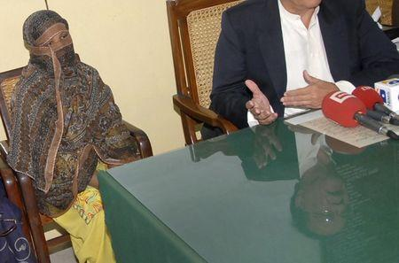 FILE PHOTO: Governor of the Punjab Province  is reflected as he spoke to media after meeting with a Pakistani Christian woman who has been sentenced to death for blasphemy, at a jail in Sheikhupura