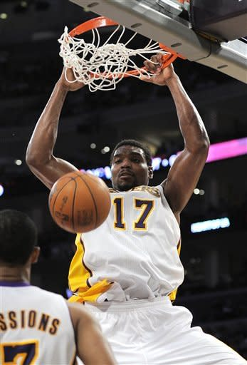 Los Angeles Lakers center Andrew Bynum dunks during the first half of an NBA first-round playoff basketball game against the Denver Nuggets, Sunday, April 29, 2012, in Los Angeles. (AP Photo/Mark J. Terrill)