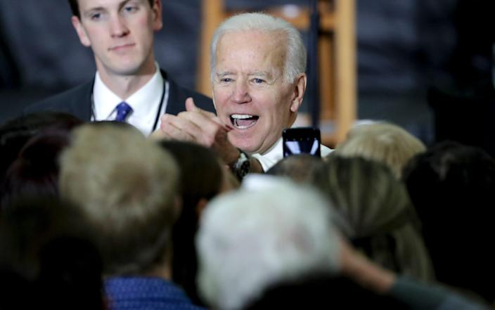 """Former Vice President Joe Biden greets supporters during a rally at the University of Wisconsin-Madison on Oct. 30, 2018. Biden called for more civility and dignity in politics, rebuking President Donald Trump and telling  students they can """"own"""" the presidential election if they vote."""