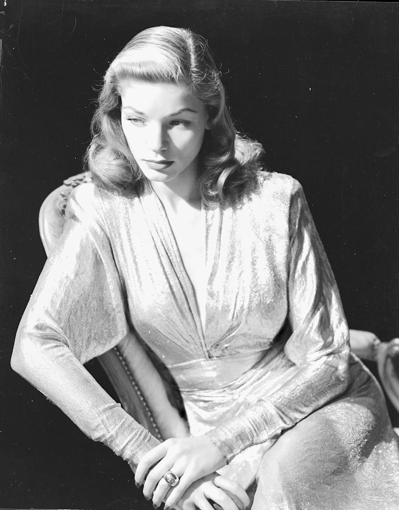 Bacall wears a silver dress in a promo image for Warner Bros. Studios, circa 1945.