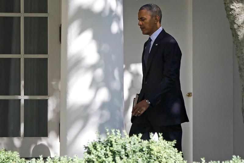 President Barack Obama walks on the West Wing colonnade towards the Oval Office of the White House in Washington, Wednesday, June 6, 2012, before travelig to San Francisco and Los Angeles. (AP Photo/Charles Dharapak)