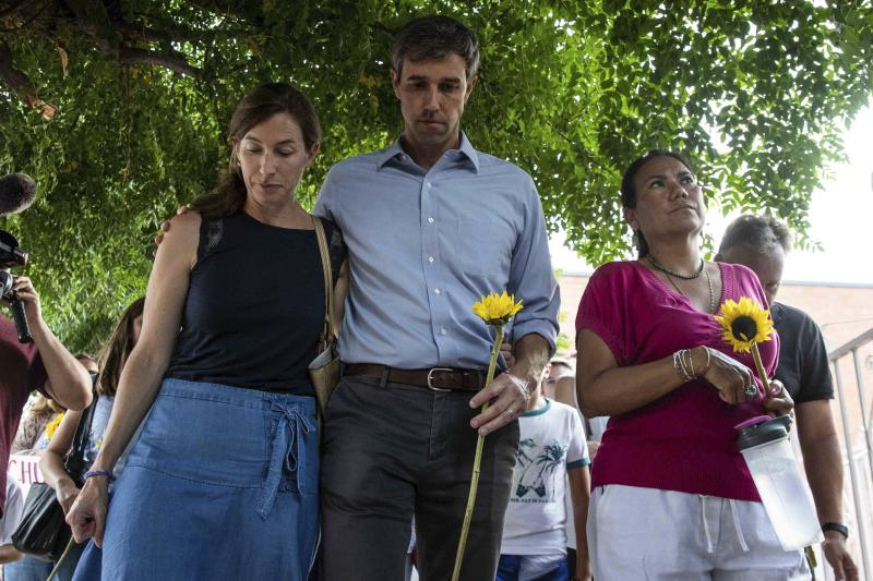 Beto O'Rourke walks next to his wife, Amy, left, Rep. Veronica Escobar during a silent march in honor to the victims of a mass shooting in El Paso, Texas, on Sunday. (Lola Gomez/American-Statesman)