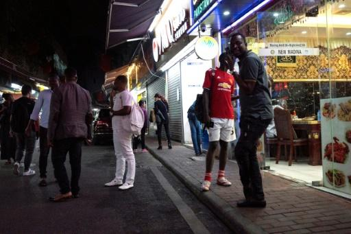 """The """"Little Africa"""" district in Guangzhou, the capital of southern China's Guangdong province, draws merchants who come to buy goods such as jewellery and electronics in bulk"""