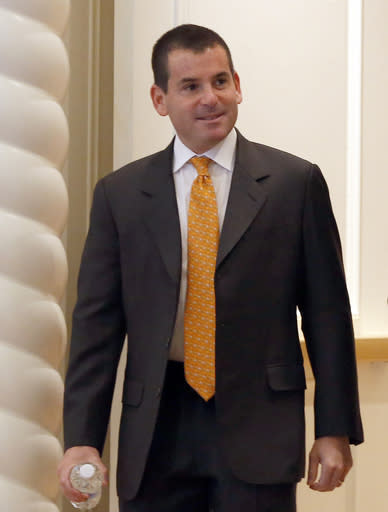 Miami Marlins president David Samson heads for morning meetings at baseball's general managers' meetings Thursday, Nov. 14, 2013, in Orlando, Fla. (AP Photo/Reinhold Matay)