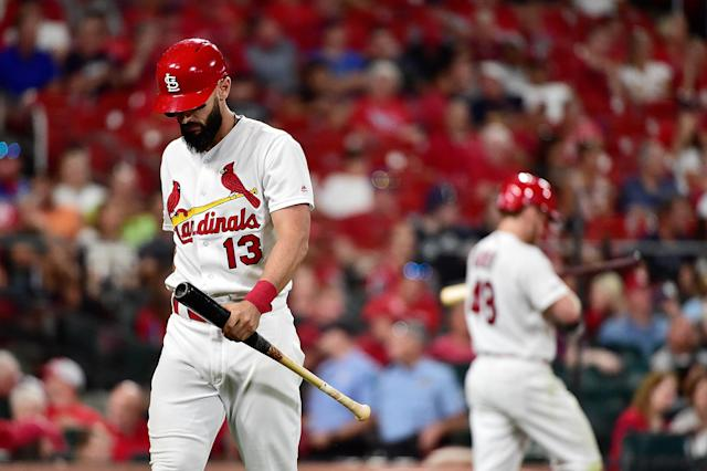 Matt Carpenter walks back to the dugout before the game is called due to rain. The Cardinals were mounting a comeback. (Photo by Jeff Curry/Getty Images)