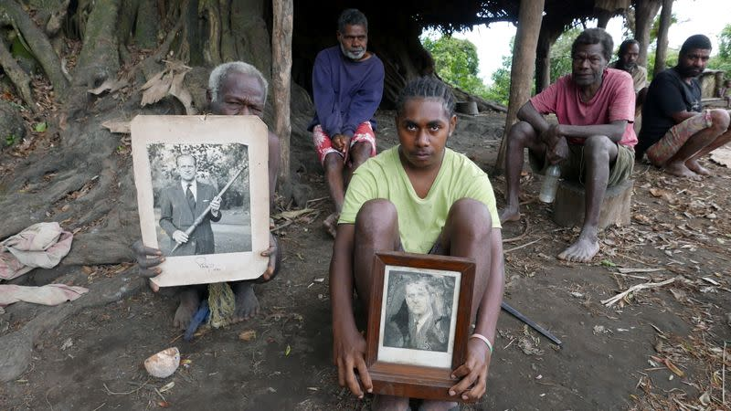 Tanna locals hold pictures of Prince Philip