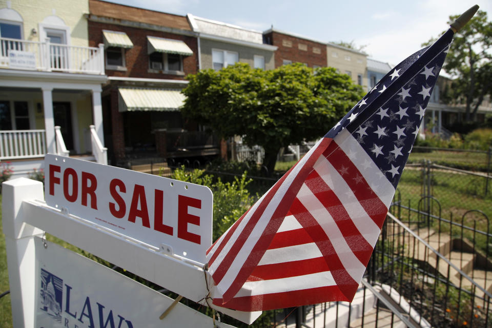 A U.S. flag decorates a for-sale sign at a home in the Capitol Hill neighborhood of Washington, August 21, 2012. President Barack Obama said on Monday the U.S. housing market was