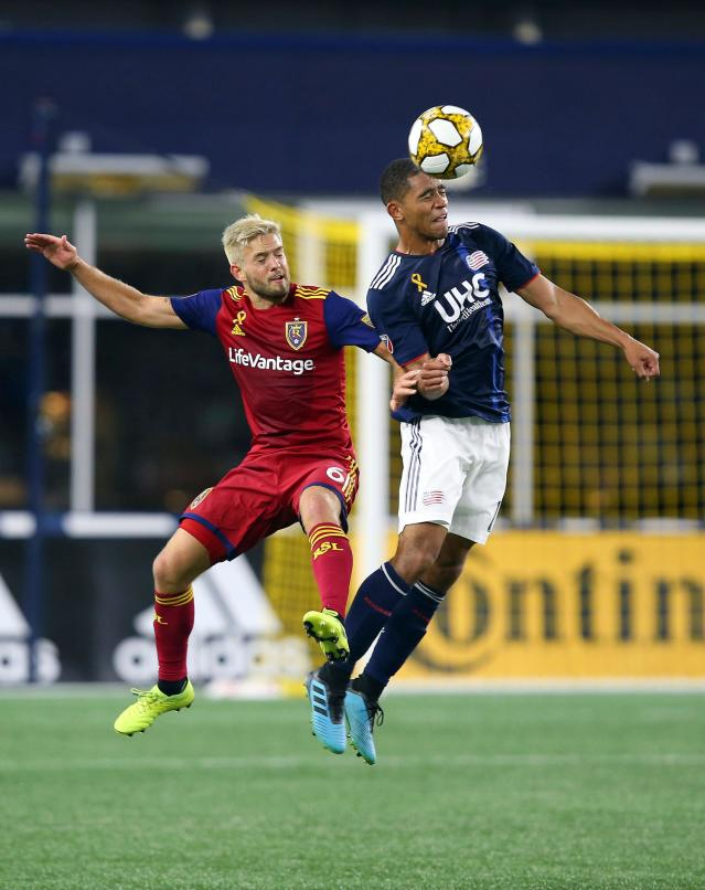 New England Revolution midfielder Brandon Bye, right, heads the ball as Real Salt Lake midfielder Kelyn Rowe (6) defends during the second half of an MLS soccer match at Gillette Stadium, Saturday, Sept. 21, 2019, in Foxborough, Mass. (AP Photo/Stew Milne)