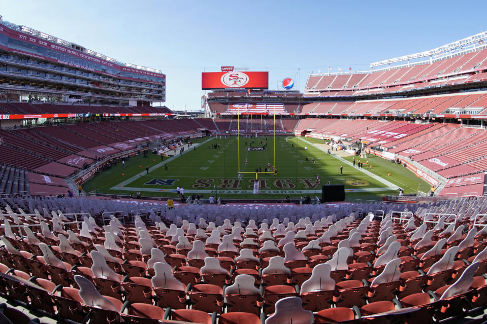 FILE - In this Oct. 4, 2020, file photo, is an empty Levi's Stadium before an NFL football game between the San Francisco 49ers and the Philadelphia Eagles in Santa Clara, Calif. California officials ramped up more mass coronavirus vaccination sites Friday, Feb. 5, 2021, amid a critical supply shortage, with one San Francisco Bay Area county announcing a mega-site capable of 15,000 shots a day even as another said it stopped first doses to ration enough for those needing their second inoculation. Santa Clara County and the 49ers said they will open California's largest vaccination site at Levi's Stadium early next week, eventually capable of injecting up to 15,000 people each day as supplies allow. (AP Photo/Tony Avelar, File)