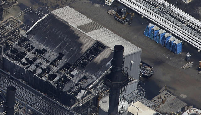 Melted portable toilets are seen at a chemical plant fire in this aerial photo about twenty miles southeast of Baton Rouge, in Geismer, La., Thursday, June 13, 2013. The plant makes highly flammable gases that are basic building blocks in the petrochemical industry. (AP Photo/Gerald Herbert)